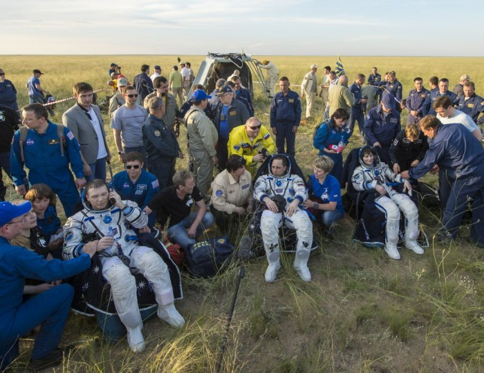 Expedition 43 commander Terry Virts of NASA, left, cosmonaut Anton Shkaplerov of the Russian Federal Space Agency (Roscosmos), center, and Italian astronaut Samantha Cristoforetti from European Space Agency (ESA) sit in chairs outside the Soyuz TMA-15M spacecraft just minutes after they landed in a remote area near the town of Zhezkazgan, Kazakhstan on Thursday, June 11, 2015. Virtz, Shkaplerov, and Cristoforetti are returning after more than six months onboard the International Space Station where they served as members of the Expedition 42 and 43 crews. Photo Credit: (NASA/Bill Ingalls)