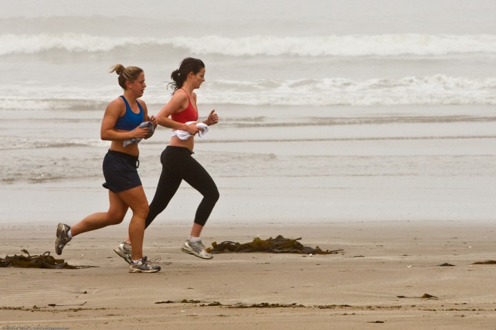 Two female joggers on foggy Morro Strand State Beach. Image credit: Mike Baird via Flickr, CC BY 2.0