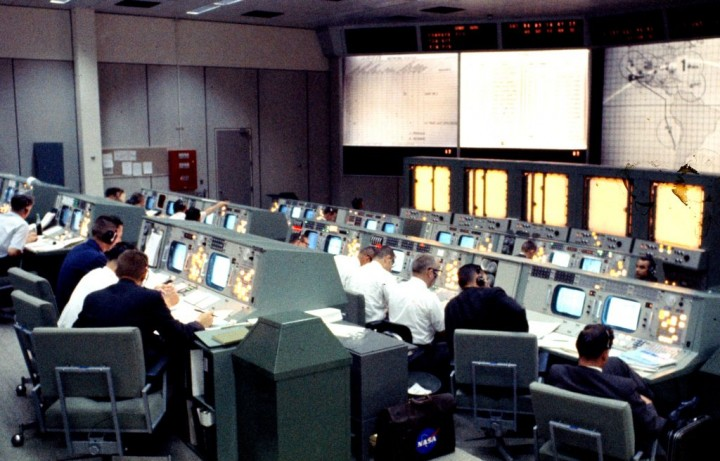 An overall view of Mission Control at the Manned Spacecraft Center in Houston during the early hours of the Gemini IV flight. In 1973, the center was renamed in honor of the late U.S. president and Texas native, Lyndon B. Johnson. Credits: NASA