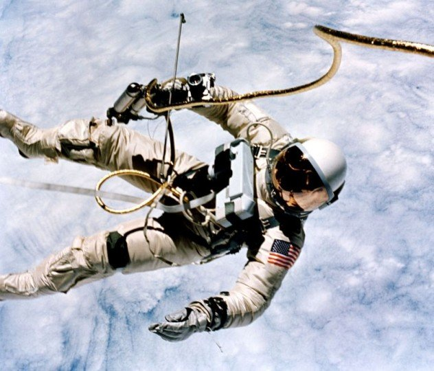"""""""This is the greatest experience, it's just tremendous,"""" said astronaut Ed White as he spacewalks outside the Gemini IV spacecraft on June 3, 1965. On his chest is an emergency oxygen pack. He is secured to the spacecraft by a 25-foot umbilical line and tether wrapped in gold tape. Credits: NASA/Jim McDivitt"""