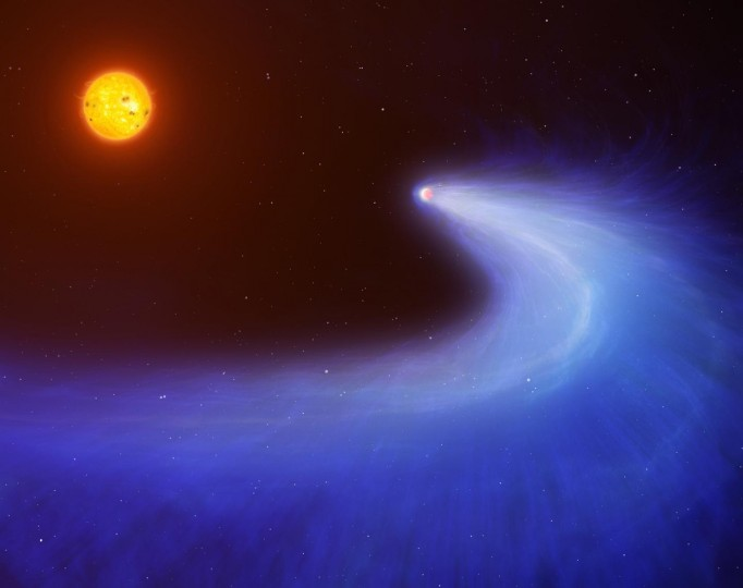 'What we can see is a large cloud of hydrogen gas absorbing the light from a red dwarf star as its exoplanet, GJ 436b, passes in front. The cloud is created as of result of x-rays emitted from the red dwarf burning off GJ 436b's upper atmosphere. 'The cloud forms a comet-like tail as a result of ultraviolet light coming from the star pushing on the hydrogen and causing it to spiral outwards. 'Around 1000 metric tonnes of hydrogen are being burnt off from GJ 436b's atmosphere every second; which equates to only 0.1 percent of its total mass every billion years. The same process is likely to be much stronger on other exoplanets, where the entire atmosphere could be removed or evaporated to destruction'. Image credit: Mark Garlick/University of Warwick