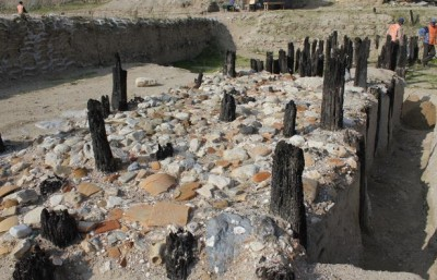 Ballast stones and broken ceramic vessels lie scattered among harbor pilings at this Byzantine harbor site excavated near the Turkish capital, Istanbul. Image credit: Charlotte Pearson