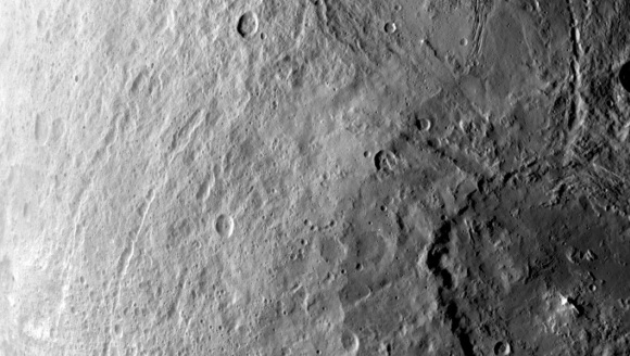 What a satisfying view! This image, also taken on June 6, shows a large crater in Ceres' southern hemisphere as well as cracks and radial fractures possibly associated with impacts. Credit: NASA/JPL-Caltech/UCLA/MPS/DLR/IDA