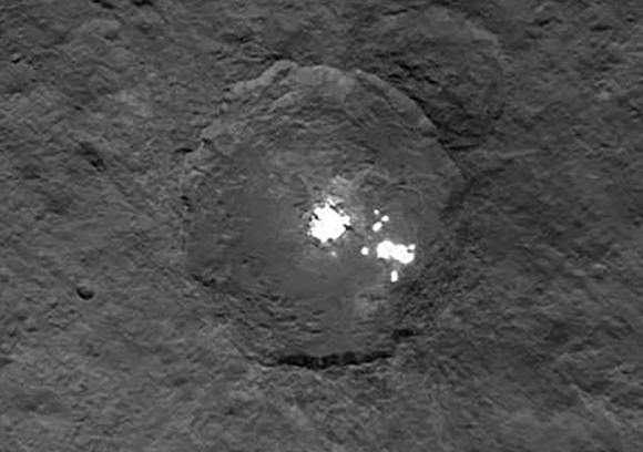 Tighter crop on the 55-mile (90-km) crater that's home to the cluster of white spots. I applied a small amount of sharpening and toned down the spots just a little. Credit: NASA/JPL-Caltech/UCLA/MPS/DLR/IDA