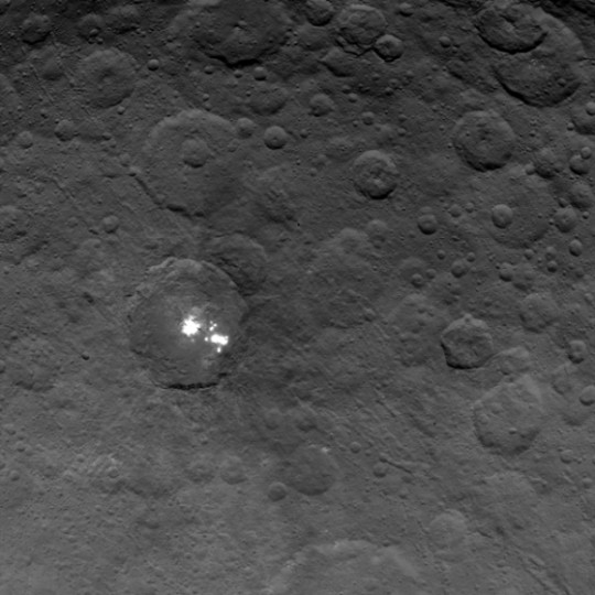 The brightest spots on dwarf planet Ceres are seen in this image taken by NASA's Dawn spacecraft on June 6, 2015. This is among the first snapshots from Dawn's second mapping orbit, which is 2,700 miles (4,400 km) in altitude. The resolution is 1,400 feet (410 meters) per pixel. Click photos for full resolution images. Credit: NASA/JPL-Caltech/UCLA/MPS/DLR/IDA