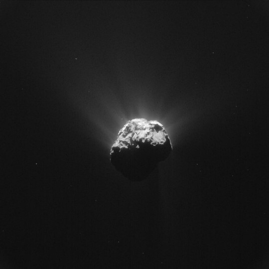 This image was taken by Rosetta's Navigation Camera at 19:38 GMT on 13 June 2015, shortly before Philae's wake-up signal was received. The signals were relayed by the Rosetta orbiter and received at ESA's European Space Operations Centre in Darmstadt at 20:28 GMT. The image was taken from a distance of 201 km from the centre of Comet 67P/Churyumov-Gerasimenko and measures 17.5 km across. The image scale is 17.1 m/pixel. The comet is orientated with the small lobe towards the right, with the large depression known as Hatmehit visible. Philae is thought to be resting just outside the rim, towards the top right in this image. Copyright ESA/Rosetta/NAVCAM – CC BY-SA IGO 3.0