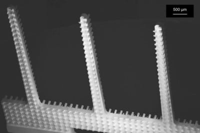 A scanning electron micrograph of the new microfiber emitters, showing the arrays of rectangular columns etched into their sides. Courtesy of the researchers