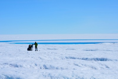 Ian Joughin and David Shean work on a GPS station nearby a supraglacial lake on the western margin of Greenland's ice sheet in 2013. Photo: Laura A. Stevens