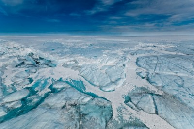 A water-filled hydro-fracture and ice blocks remain after a supraglacial lake drained on Greenland's ice sheet in 2011. Photo: Ian Joughin
