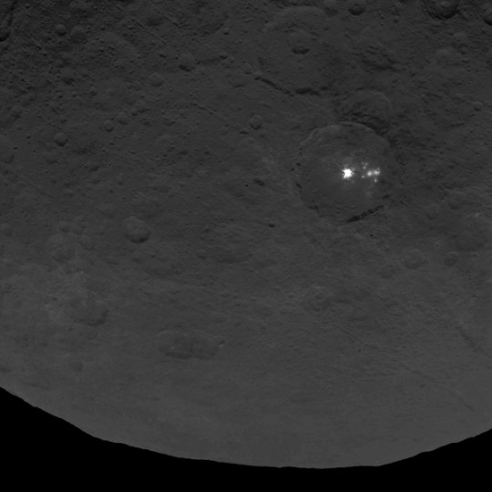 A cluster of mysterious bright spots on dwarf planet Ceres can be seen in this image, taken by NASA's Dawn spacecraft on June 9, 2015. Image credit: NASA/JPL-Caltech/UCLA/MPS/DLR/IDA