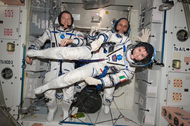 ESA astronaut Samantha Cristoforetti floating sideways with her colleagues, NASA astronaut Terry Virts (left) and cosmonaut Anton Shkaplerov in the International Space Station. They are dressed in the Sokol suits they wear in the Soyuz spacecraft that takes them to the Space Station and back. Copyright NASA