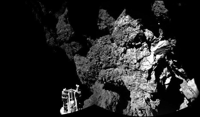 Rosetta's lander Philae is safely on the surface of Comet 67P/Churyumov-Gerasimenko, as these first two CIVA images confirm. One of the lander's three feet can be seen in the foreground. The image is a two-image mosaic. The full panoramic from CIVA will be delivered in this afternoon's press briefing at 13:00 GMT/14:00 CET. Copyright ESA/Rosetta/Philae/CIVA