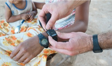 An activity logger is shown next to a wrist watch. Image credit: U of Washington