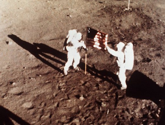 Neil Armstrong and Buzz Aldrin plant the US flag on the Lunar Surface during the first human moonwalk in history, on July 20, 1969. Credit: NASA