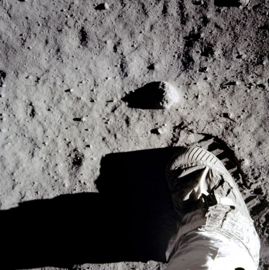 A close-up view of Apollo 11 commander Neil Armstrong's boot and boot print in the lunar soil, showing the makeup of regolith on the moon. Basalt in the soft, powdery soil could be useful in building structures on the lunar surface. Credits: NASA/ Neil Armstrong