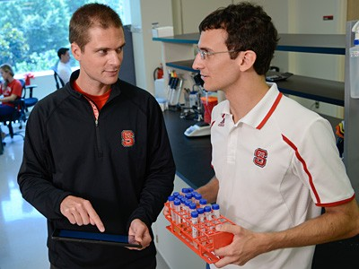 Rodolphe Barrangou (left) and Kurt Selle in Barrangou's lab on Centennial Campus. Photo by Marc Hall.