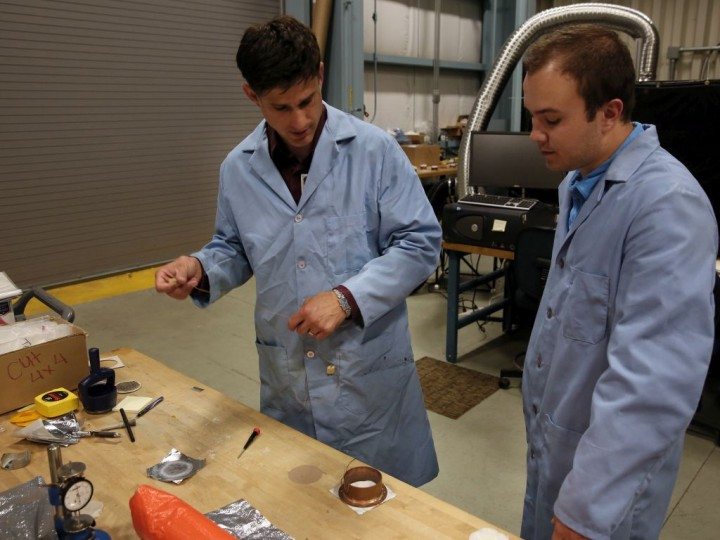 NASA CHIEFS lead engineer Josh Fody (left) works with student intern Taylor Ray to prepare samples for testing. Credits: NASA Langley/David C. Bowman