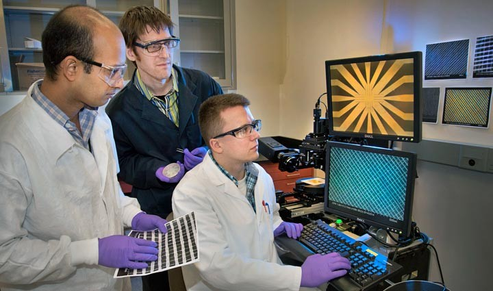 Center for Functional Nanomaterials collaborators (left to right) Atikur Rahman, Kevin Yager, and Pawel Majewski examining the precise, custom-designed nanoscale grids. Image source: BNL