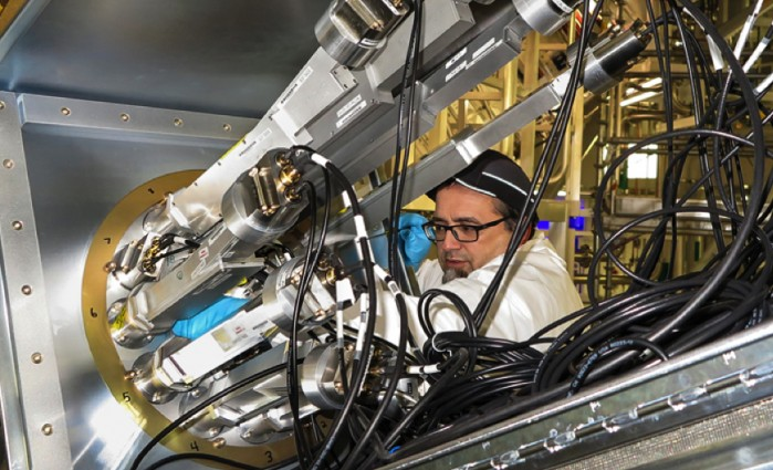 Target area operator Sky Marshall installs new apertures in the Dante 2 X-ray diodes. Photo by James Pryatel/LLNL