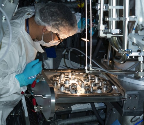 Target area operator Mike Morris inspects a Dante 1 filter wheel to ensure the delicate filters are intact before a shot. Photo by James Pryatel/LLNL