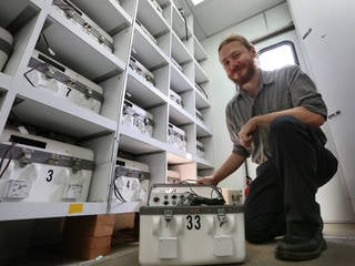 Eric Greenwood, a research aerospace engineer at NASA Langley, is pictured here in one of the center's mobile acoustic labs, in which he and other researchers can conduct field studies of rotorcraft noise. Credits: NASA/David C. Bowman