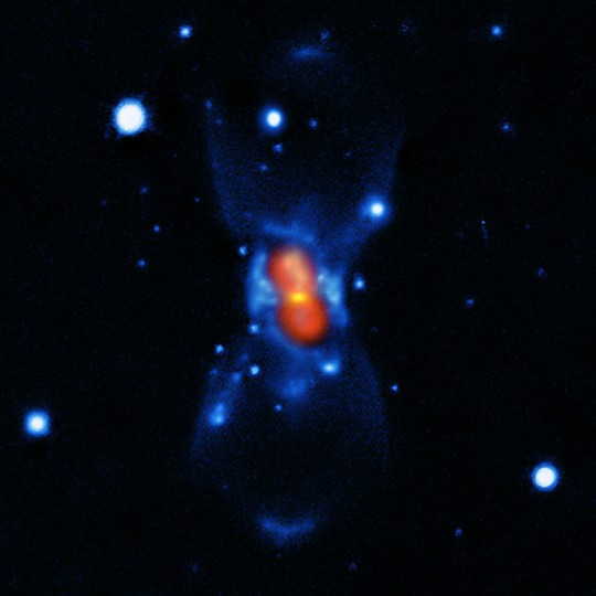 The remnant of the nova of 1670 seen with modern instruments and created from a combination of visible-light images from the Gemini telescope (blue), a submillimetre map showing the dust from the SMA (yellow) and finally a map of the molecular emission from APEX and the SMA (red). Image credit: ESO/T. Kaminski