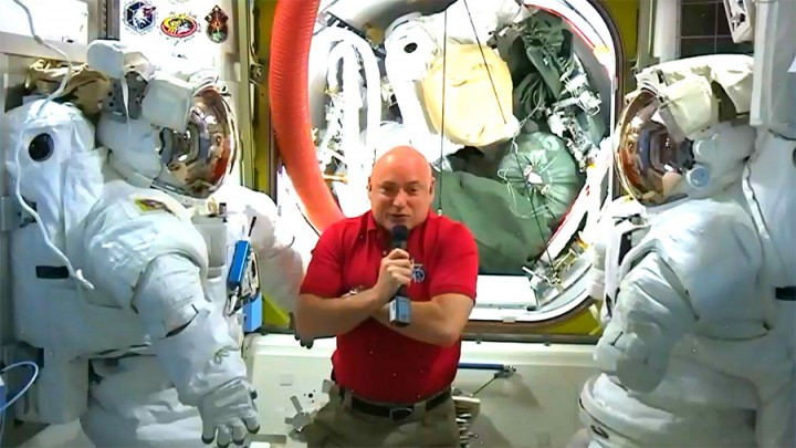 Astronaut and One-Year crew member Scott Kelly talks to the press Wednesday morning from the Quest joint airlock. Credit: NASA TV