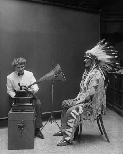Ethnographer Frances Densmore with Blackfoot chief, Mountain Chief, during a 1916 phonograph recording session for the Bureau of American Ethnology. Courtesy of: Wikimedia Commons