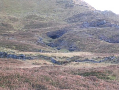 Uamh an Tartair, northwest Scotland. The mostly obscured cave entrance at the far left contains the waterfall, and is one of several entrances. The part of the cave from where the stalagmites were studied is above and to the left of the visible entrance in the centre of the picture.