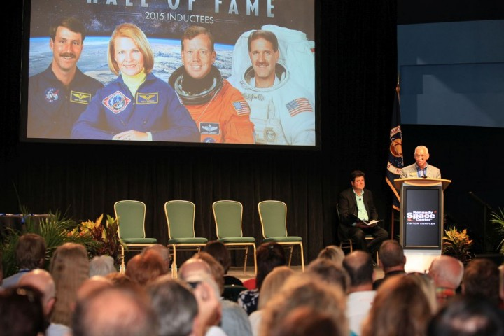 NASA Administrator Charles Bolden addresses the crowd at U.S. Astronaut Hall of Fame 2015 induction ceremony on May 30, 2015 at the Kennedy Space Center Visitor Complex in Florida. Ceremony emcee John Zarrella is seated behind Bolden. Credits: NASA