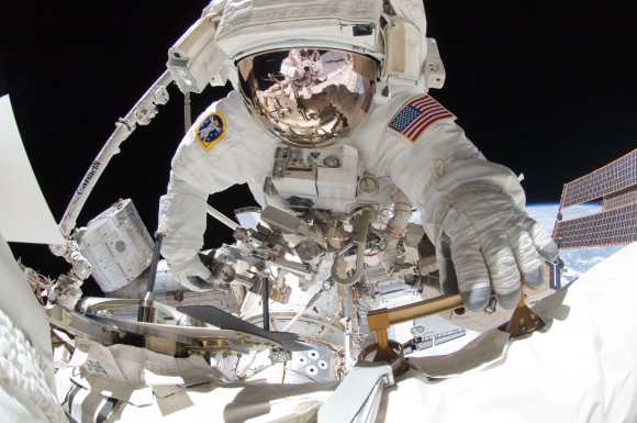 NASA astronaut Greg Chamitoff during a 2011 spacewalk on the International Space Station. Reflected in his visor is NASA crewmate Mike Fincke. Both astronauts were mission specialists aboard shuttle mission STS-134. Credit: NASA