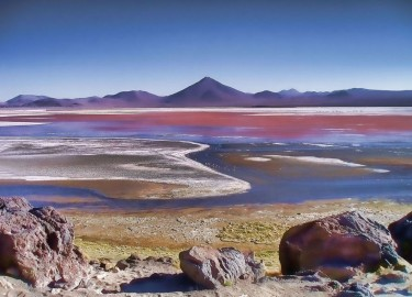 Laguna Colorada is a shallow salt lake in the southwest of Bolivia. One of several places on Earth whose colors are affected by nonphotosynthetic pigments. UW doctoral student Eddie Schwieterman has published research on how such nonphotosynthetic biosignatures might appear on exoplanets, or those outside our solar system. Image credit: Noemí Galera / Flickr