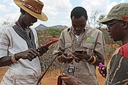 ARS researchers and their cooperators have developed easy-to-use mobile phone apps to help even non-scientists in Kenya (shown here) and around the world collect and share soil, land-cover and climate data. Photo courtesy of A. Beh, New Mexico State University.