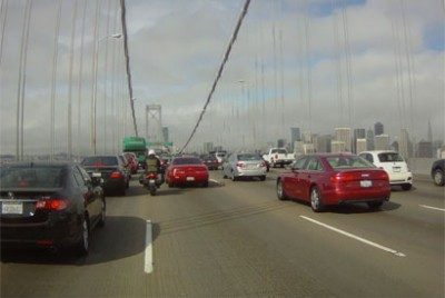 Motorcyclist lane-splitting on the Bay Bridge in California. This practice might not be as risky as some would think, according to a new analysis. (Photo by Surj Gish)