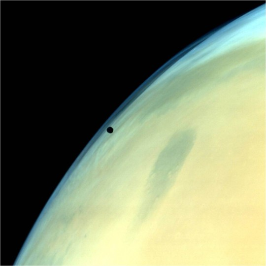 Phobos, one of the two natural satellites of Mars silhouetted against the Martian surface. Credit: ISRO