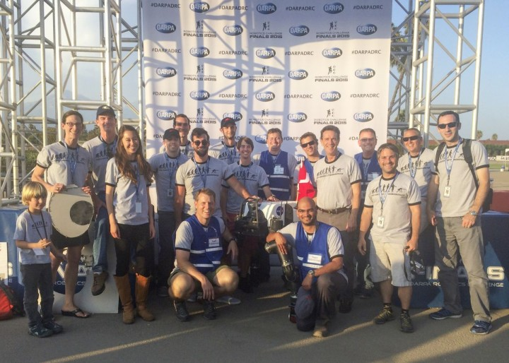 """Many members of Team RoboSimian and a few guests gather with competition hardware at a """"Meet the Robots"""" event during the DARPA Robotics Challenge Finals in Pomona, California, on June 6, 2015. Credits: JPL-Caltech"""