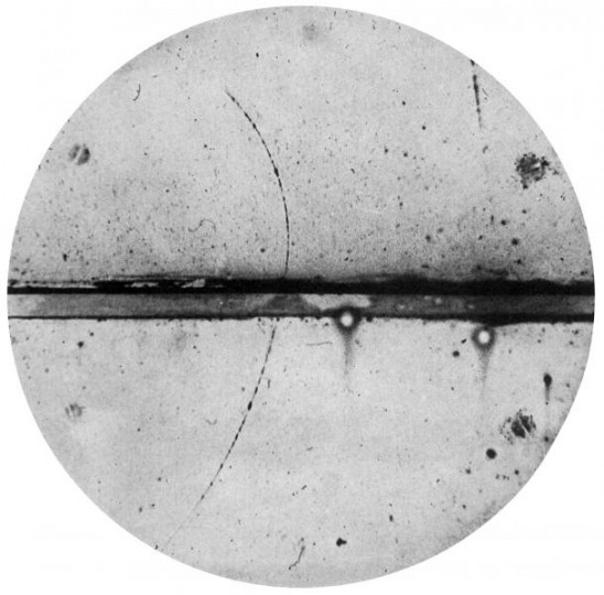 This photograph, taken in 1932 by American physicist Carl D Anderson (link is external), shows a track left by the first positron ever identified. The line across the centre of the image is a 6 millimetre lead plate separating the upper and lower halves of the chamber. (Image: Wikimedia Commons)