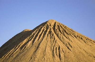 Does the brain respond to input the same way a sand pile responds to the addition of more sand?