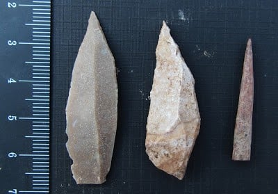 """Two stone tool points made using a prismatic blade technique (left and center), and a bone point or needle (right). The finds """"give us a new window onto a transitional time, on the cusp of modern human cultural behaviors,"""" says anthropologist Aaron Stutz. Image credit:"""