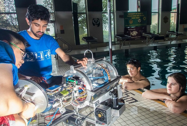 Members of the UAlberta Autonomous Robotic Vehicle Project test their sub in the waters of the Van Vliet Centre pool.