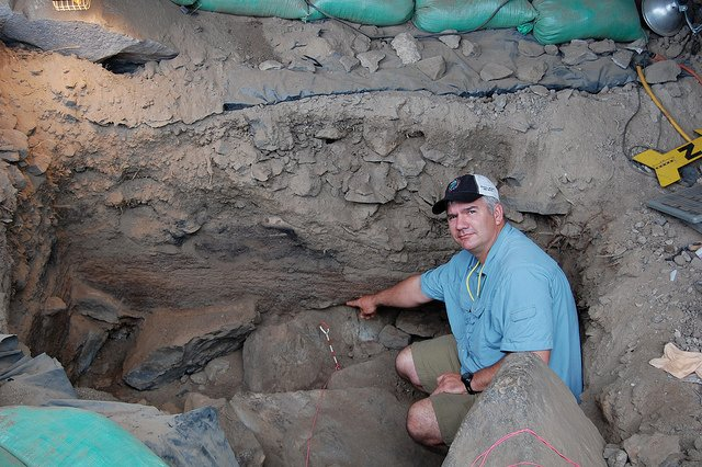 Oregon State University anthropologist Loren Davis at Paisley Caves in Oregon, site of some of the oldest human artifacts in the Amerias. (photo courtesy of Loren Davis)