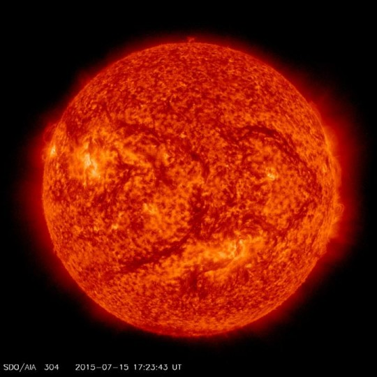This image of the sun was taken by NASA Solar Dynamics Observations mission on July 15, 2015, at a wavelength of 304 Angstroms. Image credit: NASA Solar Dynamics Observations