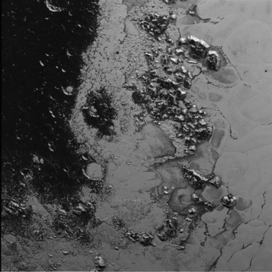 A newly discovered mountain range lies near the southwestern margin of Pluto's Tombaugh Regio (Tombaugh Region), situated between bright, icy plains and dark, heavily-cratered terrain (left). This image taken on July 14, 2015 from a distance of 48,000 miles (77,000 km) and received on Earth on July 20. Features as small as a half-mile (1 km) across are visible. Credits: NASA/JHUAPL/SWRI