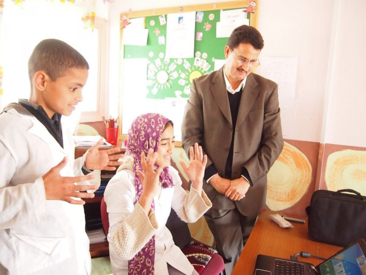 Computational linguist Abdelhadi Soudi, on the right, works with two students in a Moroccan classroom. Soudi and Corinne Vinopol, president and CEO of the Institute for Disabilities Research and Training Inc., are joint investigators on a NSF-USAID award. They built software that allows for real-time translation between Standard Arabic and Moroccan Sign Language. Credit: Courtesy of Abdelhadi Soudi, Ecole National de l'Industrie Minerale, Morocco.