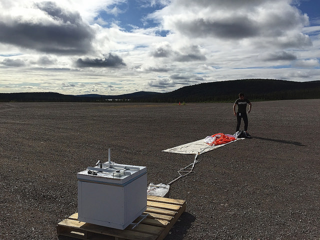 In the first week in Sweden, the BARREL team put their balloon mission through a variety of tests. This image from Aug. 4, 2015, shows Nick Lavers, an undergraduate at the University of California at Berkeley, unraveling a balloon during a Comprehensive Flight Test on the Esrange Space Center balloon launch pad. The NASA-funded BARREL – which stands for Balloon Array for Radiation-belt Relativistic Electron Losses – measures electrons in the atmosphere near the poles. Such electrons rain down into the atmosphere from two giant radiation belts surrounding Earth, called the Van Allen belts. BARREL's third campaign includes launching six balloons from the Esrange Space Center in Kiruna, Sweden. BARREL is led by Dartmouth College in Hanover, New Hampshire. Credit: NASA/Dartmouth/Kathryn Waychoff