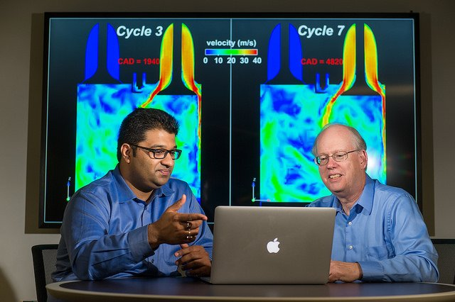 Argonne principal mechanical engineer Sibendu Som (left) and computational scientist Raymond Bair discuss combustion engine simulations conducted by the Virtual Engine Research Institute and Fuels Initiative (VERIFI). The initiative will be running massive simulations on Argonne's Mira supercomputer to gain further insight into the inner workings of combustion engines. Image credit: ANL