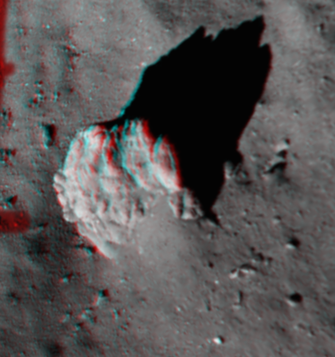 This image, created from Philae's ROLIS descent camera, focuses on the largest boulder seen in the image captured at 67.4 m above Comet 67P/Churyumov–Gerasimenko. It is best viewed with red/blue–green glasses. The 3D view highlights the fractures in the 5 m-high boulder, along with the tapered 'tail' of debris and excavated 'moat' around it. This 'tail' feature has also been identified around boulders elsewhere on the comet in OSIRIS images taken from orbit. The ROLIS team thinks the tails appear as a result of the region 'behind' an obstacle being shielded from erosion via the impact of falling particles arriving in a prevailing direction, perhaps from activity elsewhere on the comet. Copyright ESA/Rosetta/Philae/ROLIS/DLR