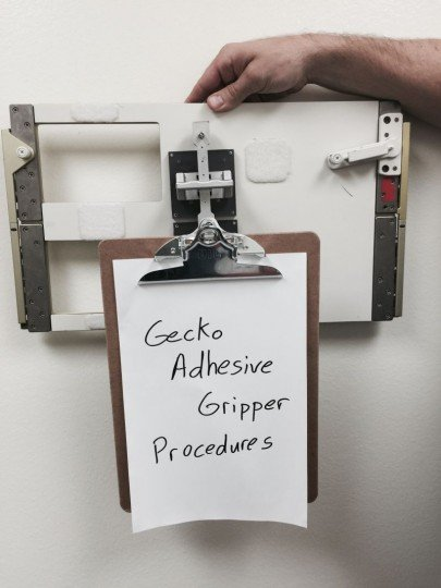 The gecko grippers could one day be used to mount objects on the inside of the International Space Station. This image shows a gripper attaching a clipboard to a spare panel -- the same kind found inside the United States' modules of the station. Credits: NASA/JPL-Caltech