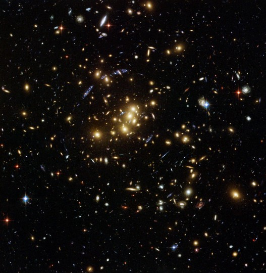 Dark matter is invisible kind of matter that is still only hypothetical – although scientists have calculated its existence, no one has proven it is real yet. It accounts for 63% of all the matter in our universe and discovery of it would be a tremendous leap forward in modern physics and astronomy. Image credit: NASA, ESA, M.J. Jee and H. Ford (Johns Hopkins University) via Wikimedia, Public Domain