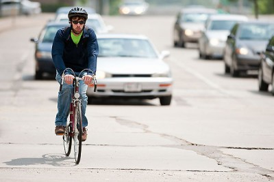 A cyclist makes his way along Park Street on the University of Wisconsin-Madison campus. Image credit: Bryce Richter